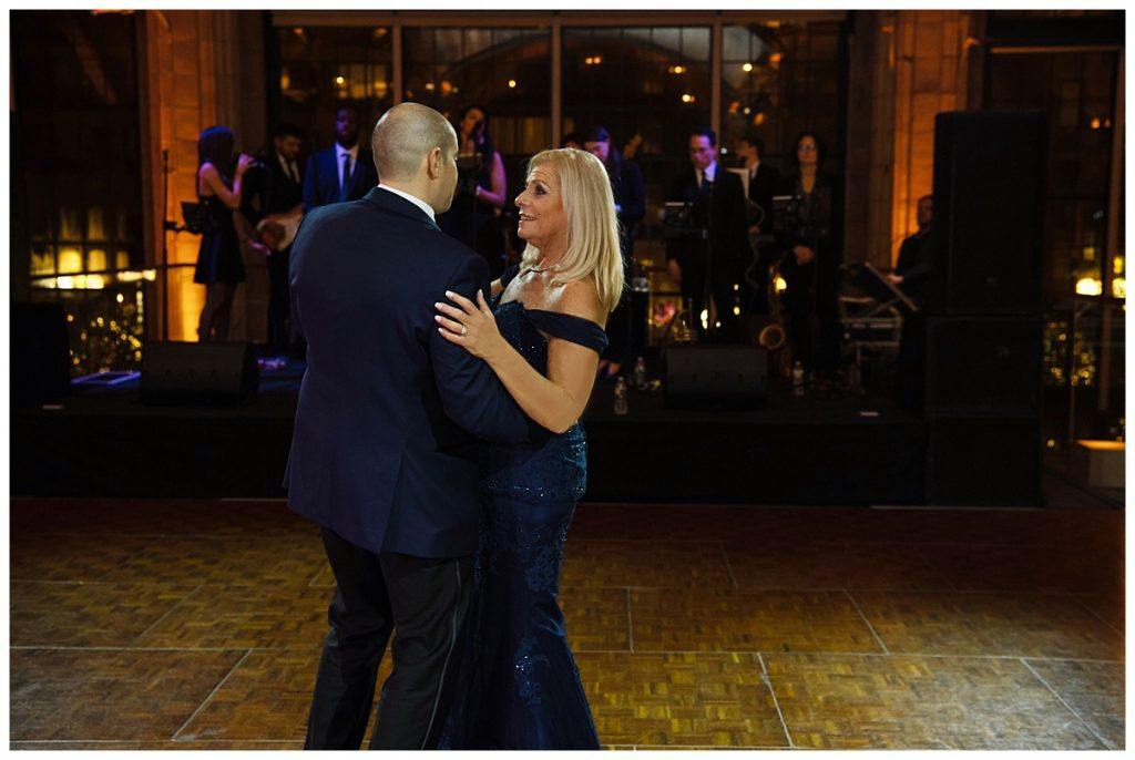 A groom dancing with his mother during a wedding reception at Guastavinos in New York City.