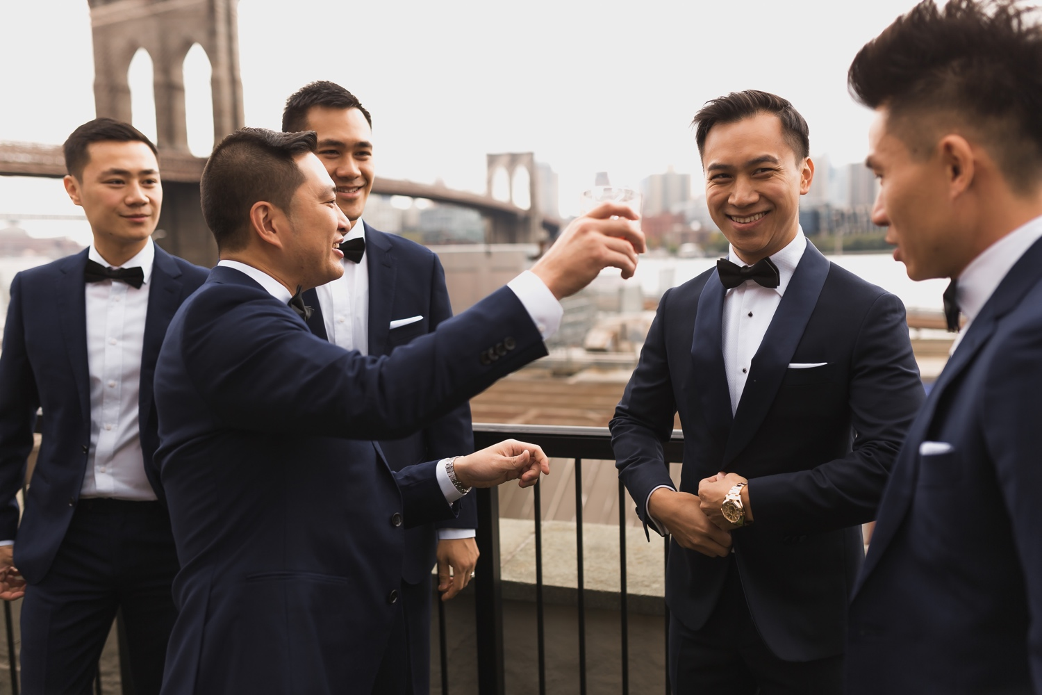 A groom and his groomsmen getting ready in a Mr. C Seaport Hotel for his wedding at Cipriani Wall Street in New York City.