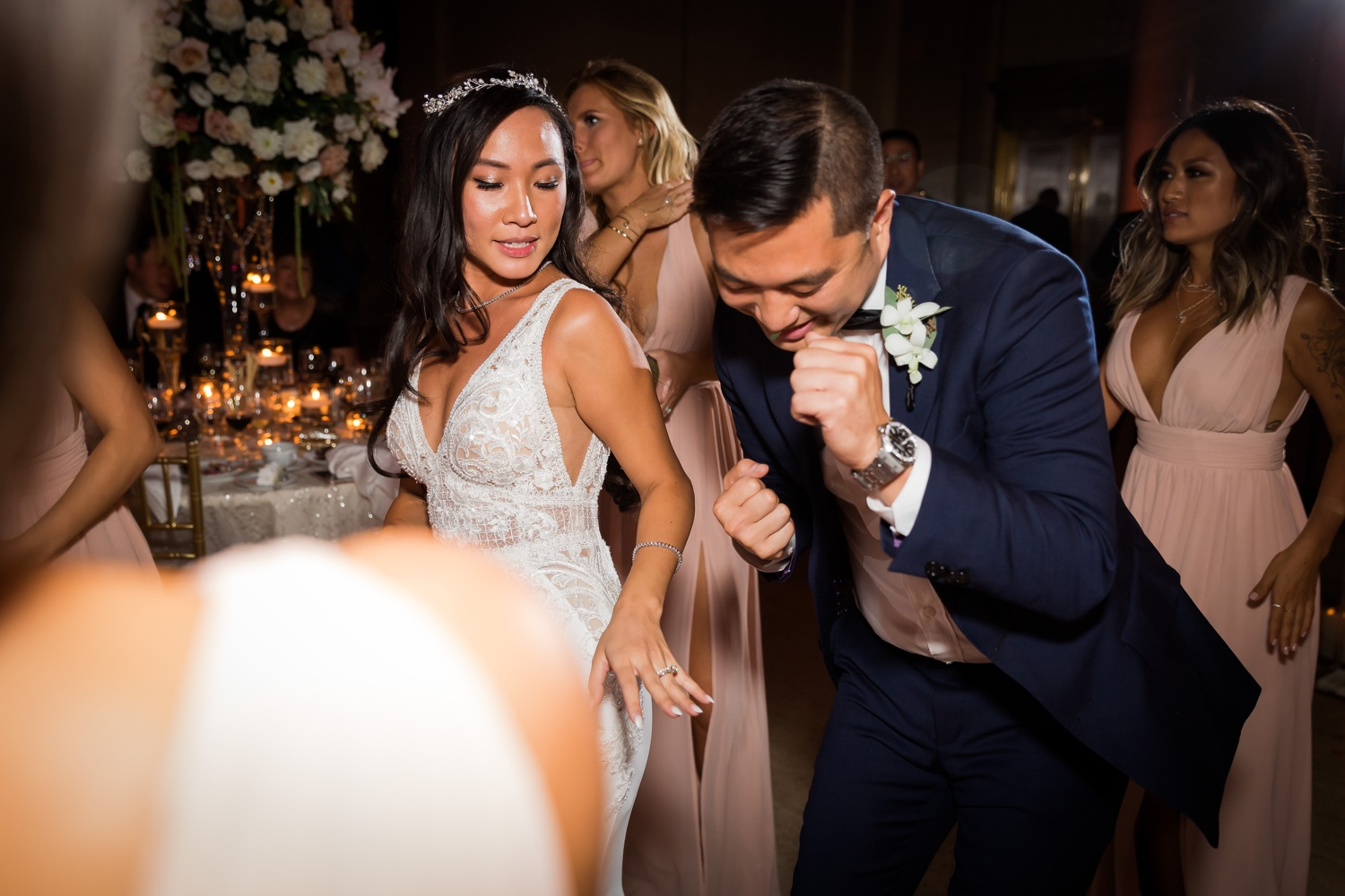 A bride dancing with a groomsman during
