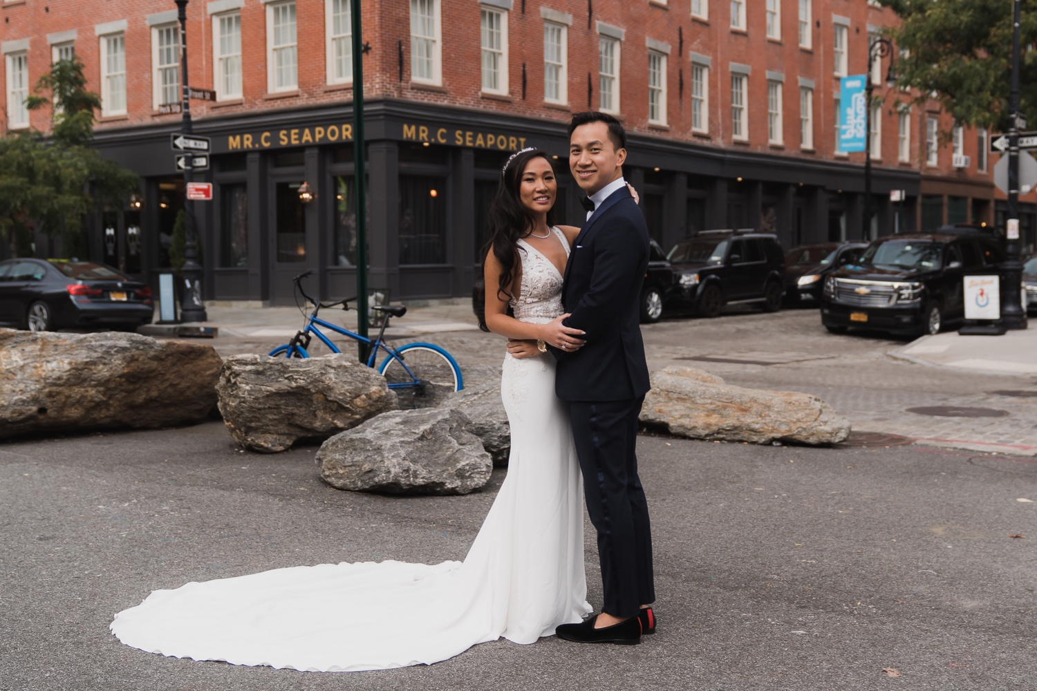 A first look session of a bride and a groom near Mr. C Seaport Hotel on a wedding day at Cipriani Wall Street. Wedding Dress by Pronovias