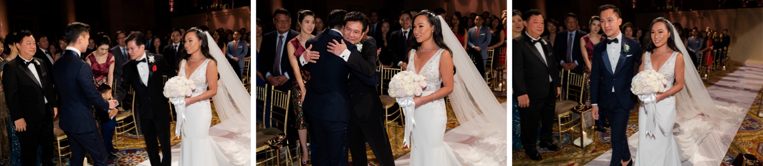 A bride's father hugging a groom and wishing the couple well during a wedding ceremony at Cipriani Wall Street in New York City.