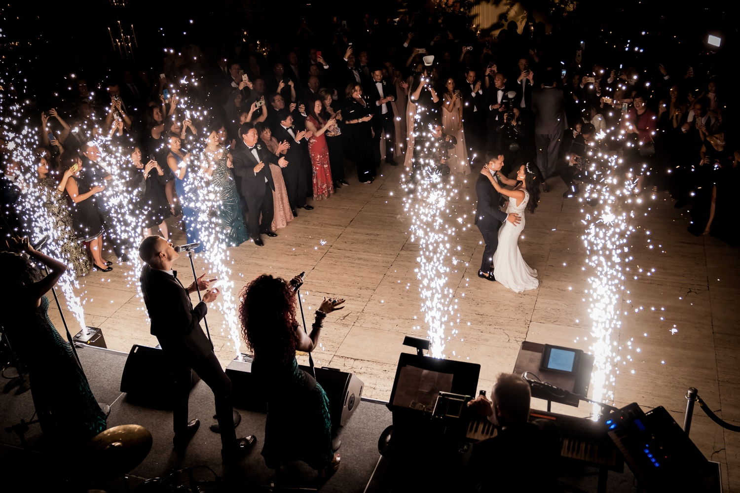 A first dance as a husband and wife during a wedding reception at Cipriani Wall Street in New York City. Wedding Dress by Pronovias