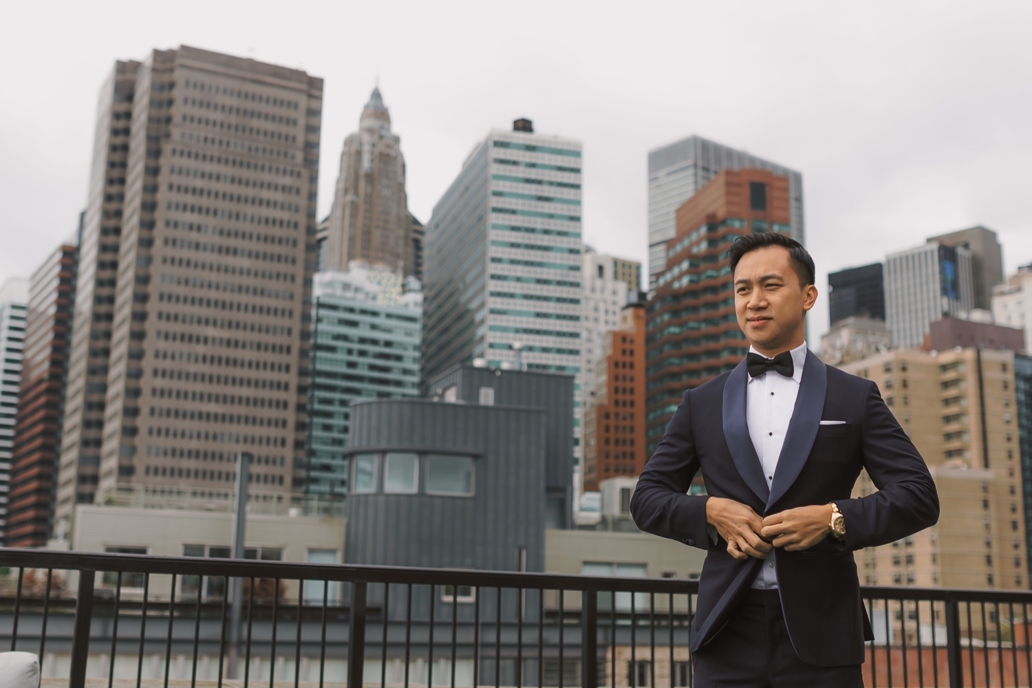 A groom wearing his wedding suit in a Mr. C Seaport Hotel on a wedding day at Cipriani Wall Street in New York City.