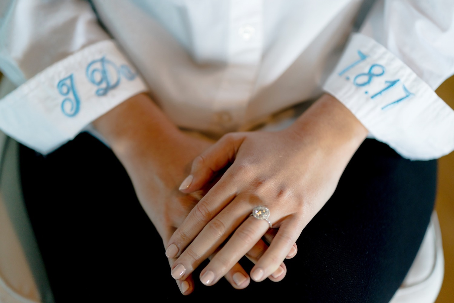 Bride wearing her engagement ring at Liberty Warehouse in Brooklyn, New York.