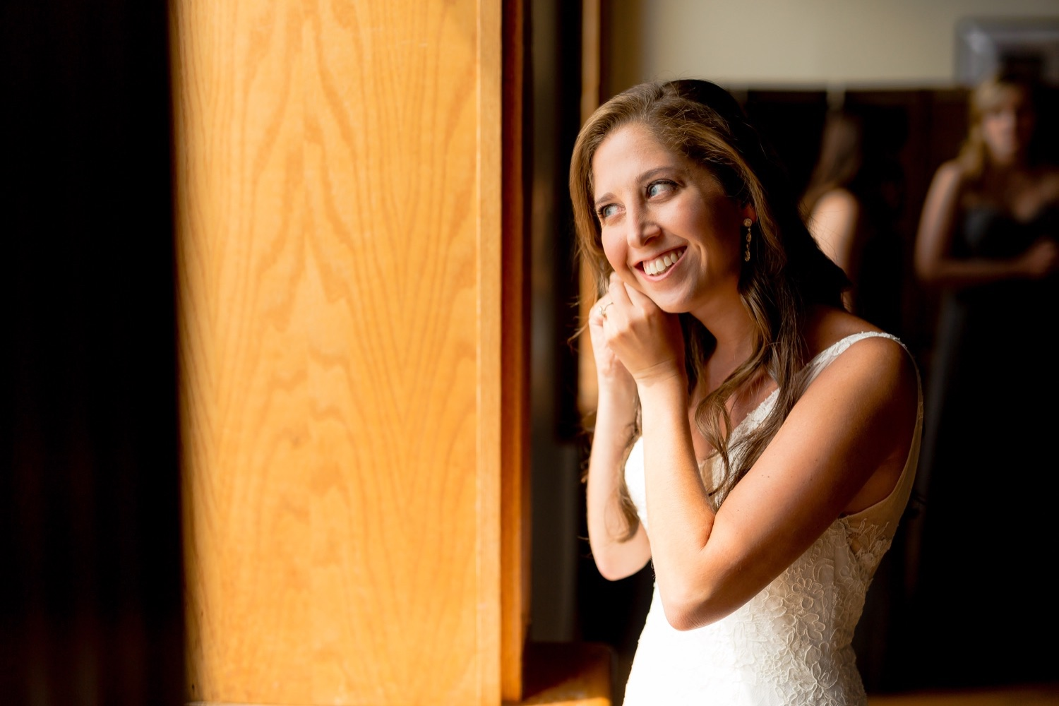 Bride putting her earring at Liberty warehouse, Brooklyn New York.