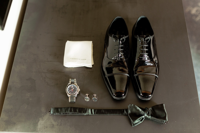 A groom's cufflinks inside a wedding venue at Liberty Warehouse in Brooklyn, New York.