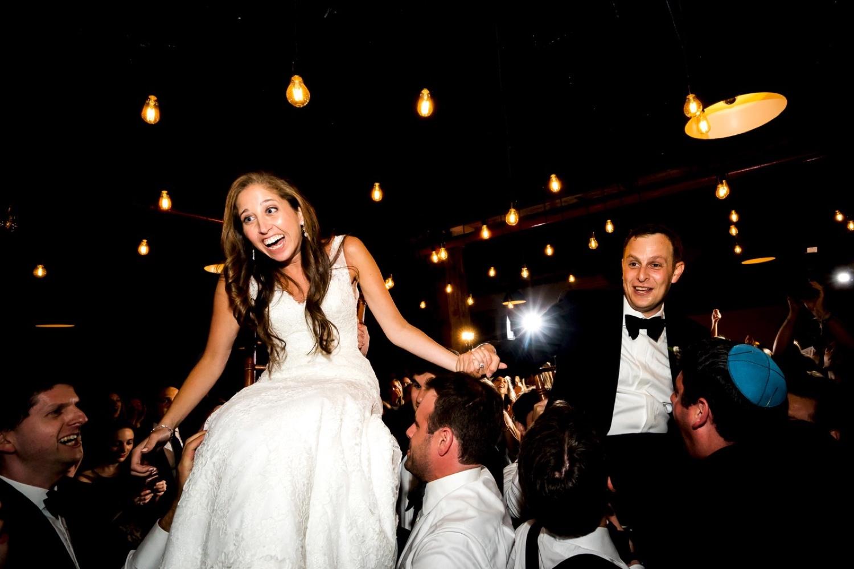 A horah during a wedding reception at Liberty Warehouse, Brooklyn New York.