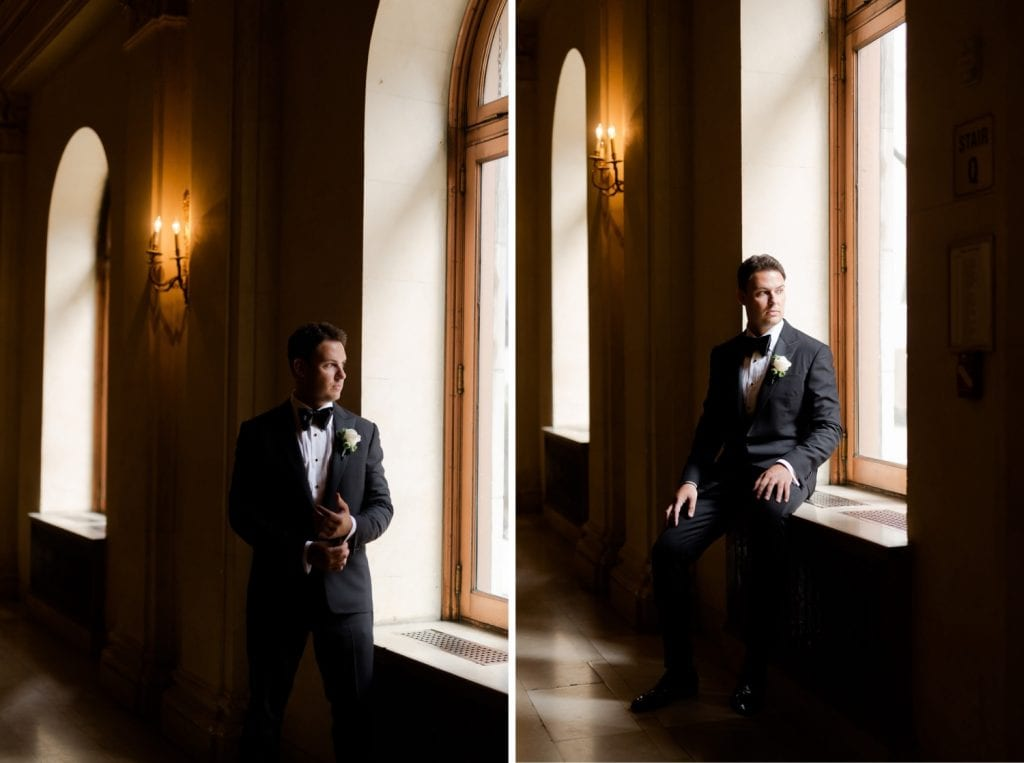 A groom posing for a portrait picture at the  Plaza Hotel NYC in New York.