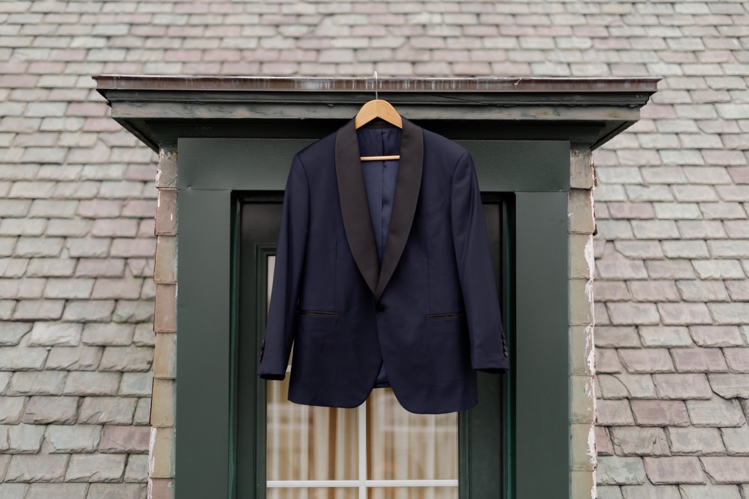 A wedding suit hanging outside.