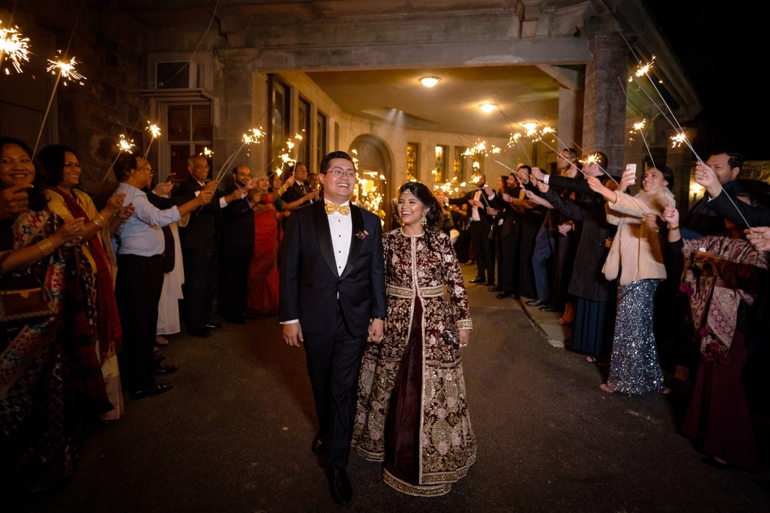 A newly wedded couple exiting their wedding venue end of the night at the Tappan Hill Mansion.