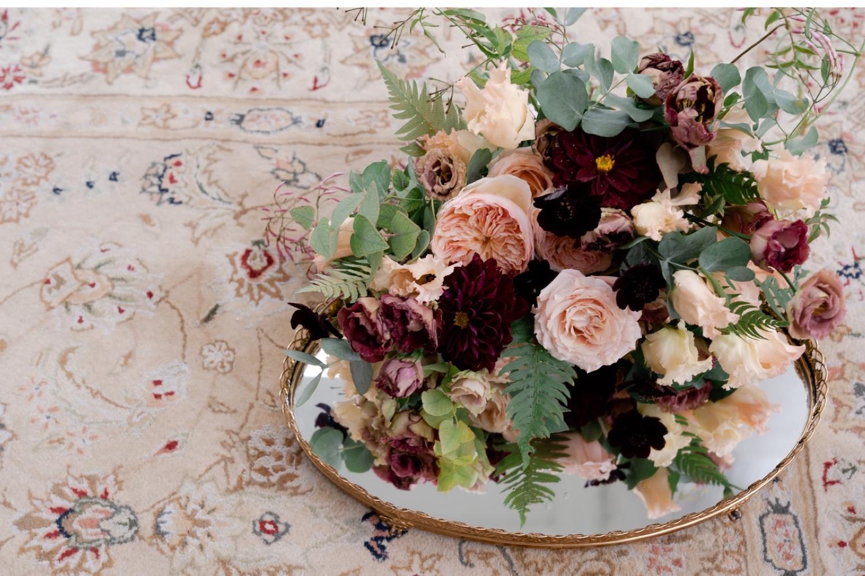 A wedding bouquet on a mirror.