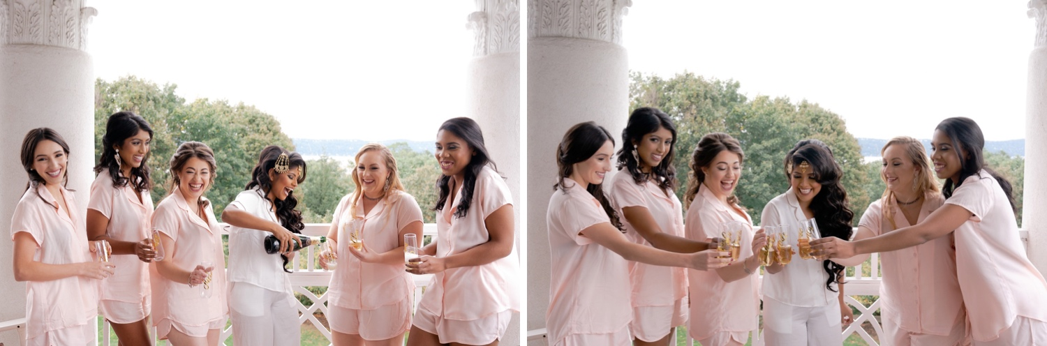 A bride pouring a champagne to her bridesmaids at .the Tappan Hill Mansion