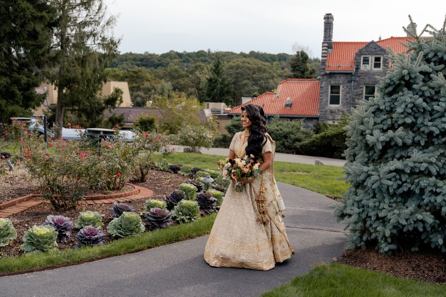 A bride walking towards her bride during a first look on a wedding day at the Tappan Hill Mansion.