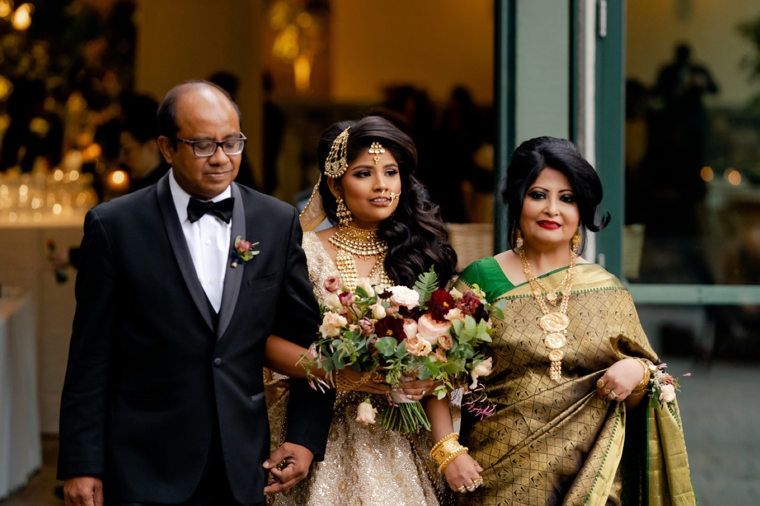 A bride and her parent coming to the wedding ceremony at the Tappan Hill Mansion.