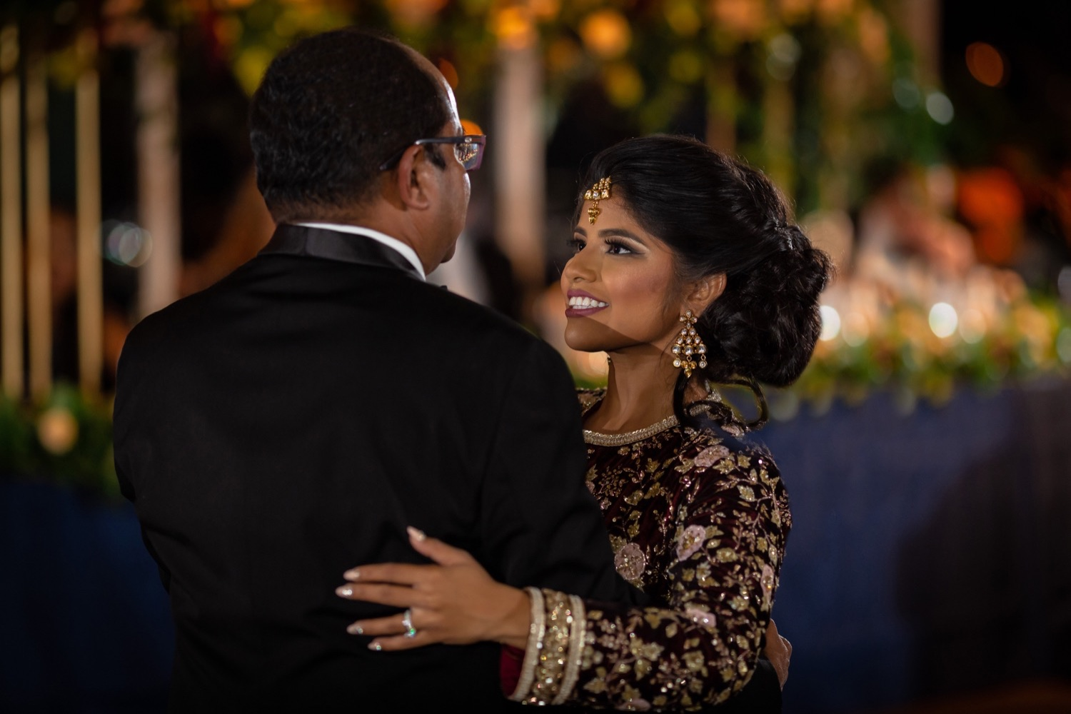 A bride dancing with her father during a wedding reception at the Tappan Hill Mansion.