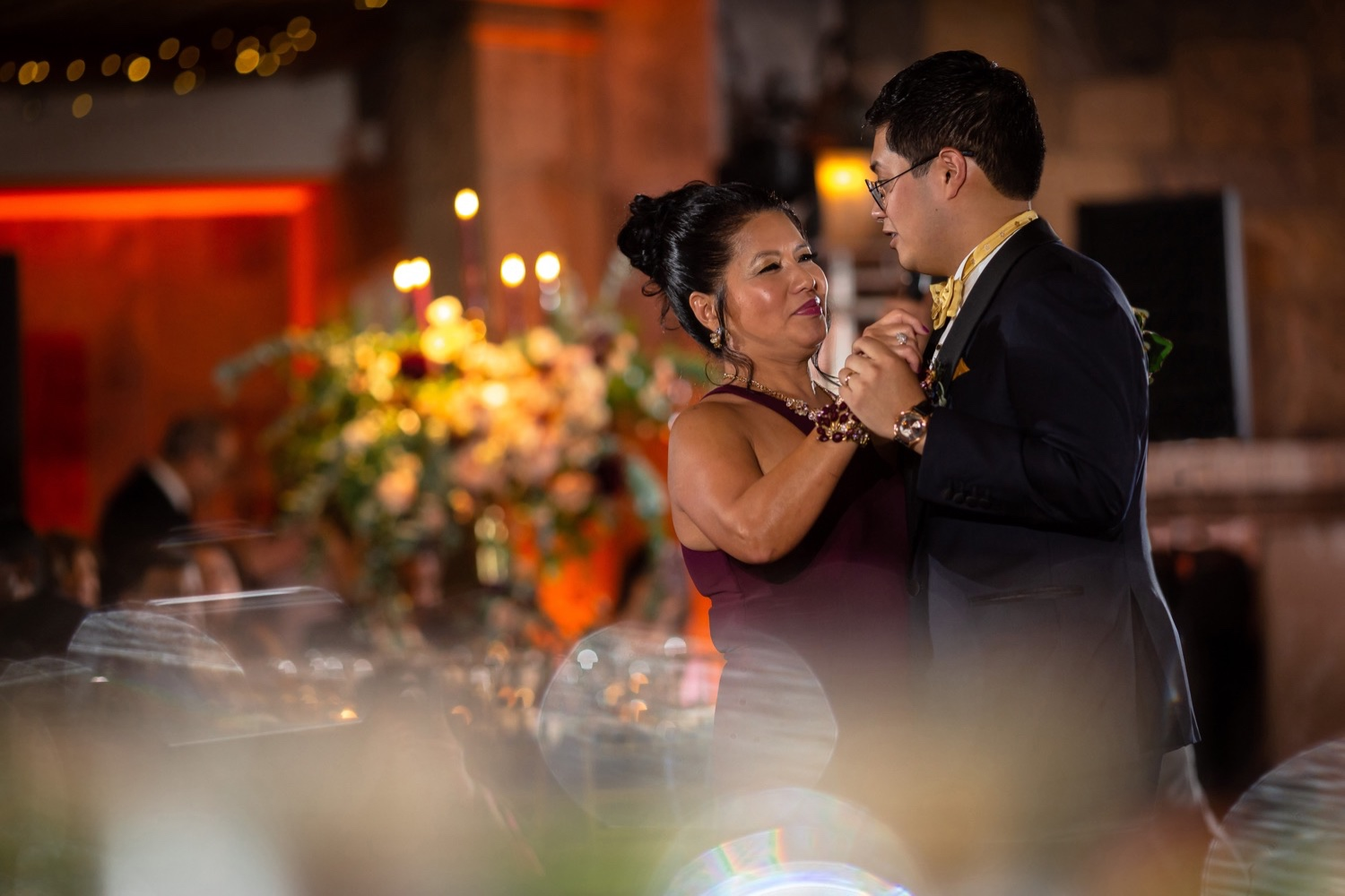 A groom dancing with his mother during a wedding reception at the Tappan Hill Mansion.