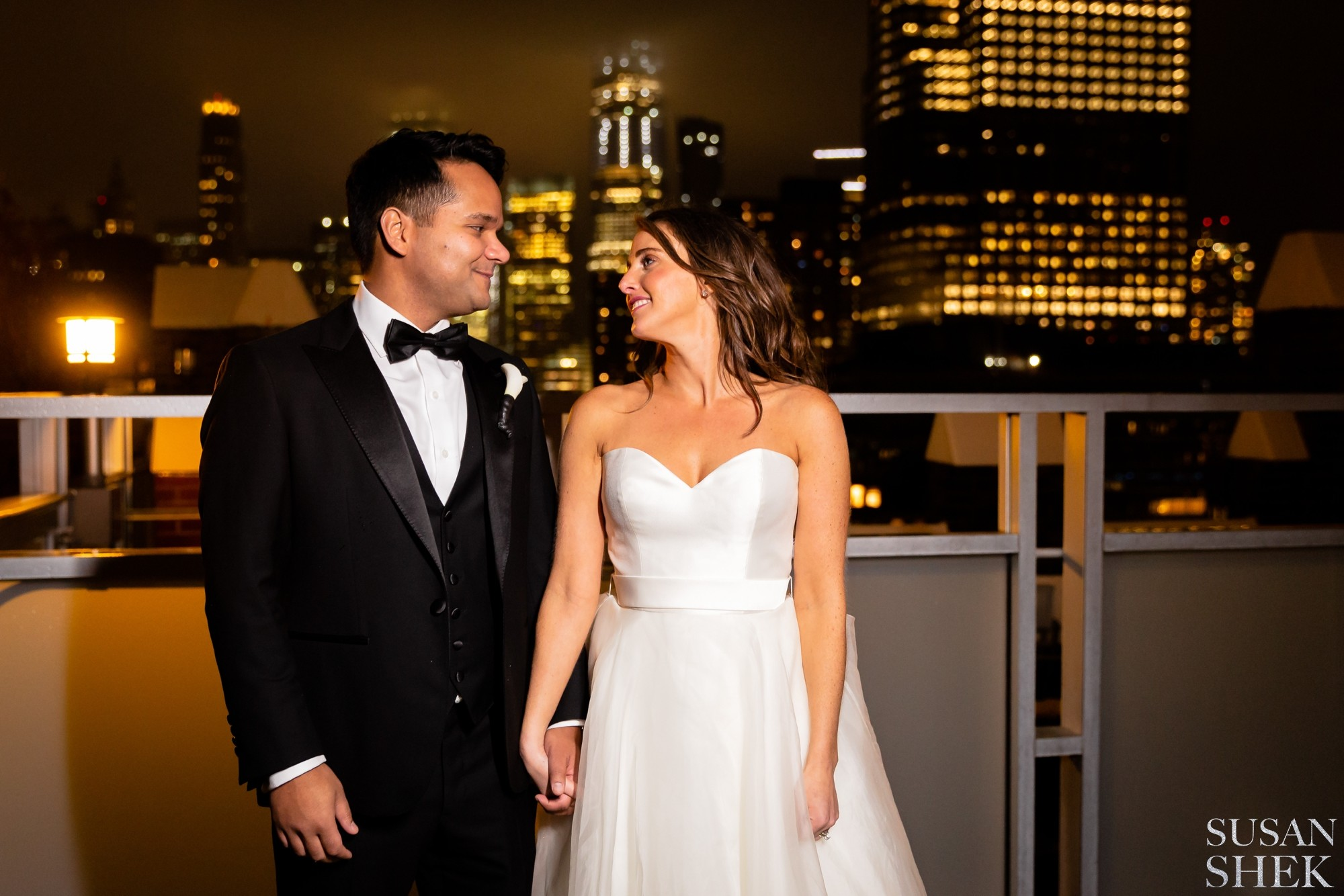 bride and groom portraits at night in tribeca rooftop