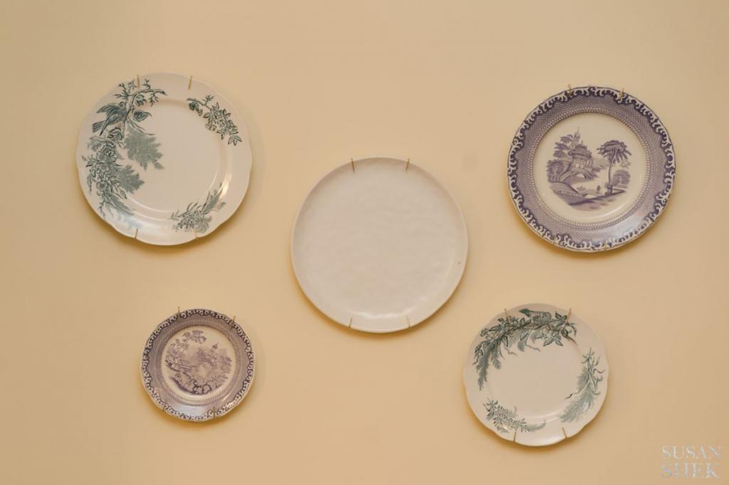 vintage plates on the wall at blue hill stone barns