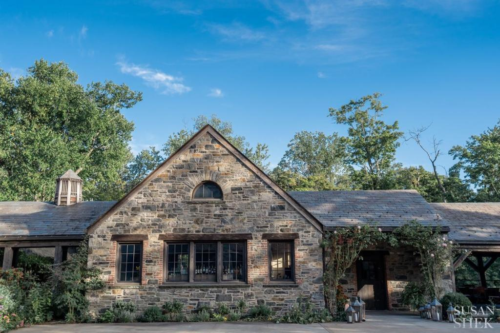 the outside facade of the restaurant entrance of blue hill stone barns