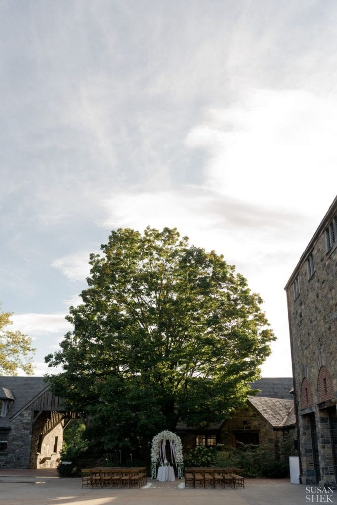 wide shot of the wedding ceremony at blue hill stone barns
