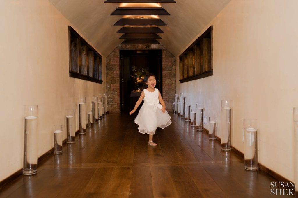 girl running through the hallway of blue hill stone barns