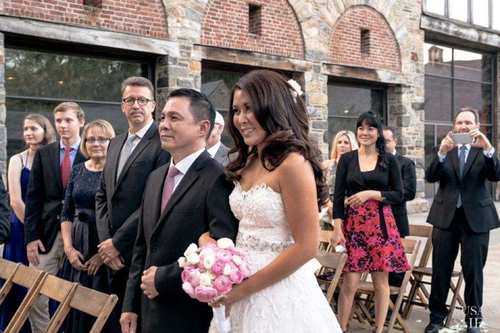 bride looking at groom at blue hill stone barns wedding aisle
