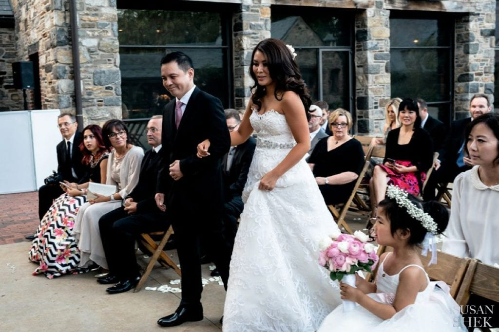 walking down the wedding aisle at blue hill stone barns ceremony