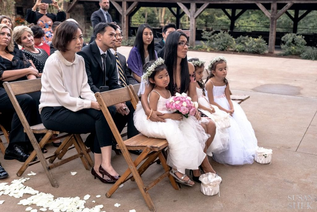 flower girls watching ceremony blue hill stone barns