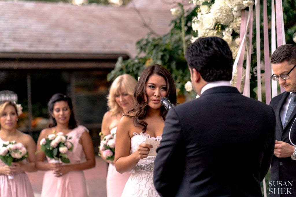 bride reading her vows at blue hill stone barns