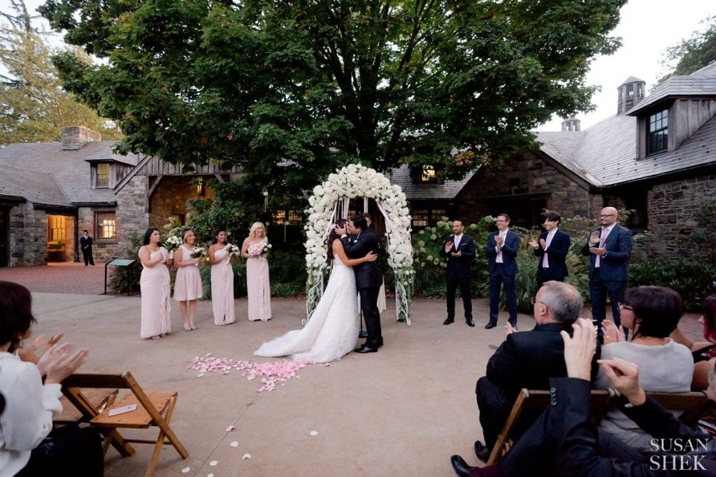 first kiss at blue hills stone barn ceremony